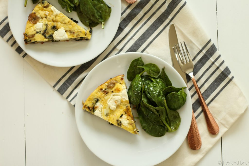 This savory frittata gets lots of flavor from caramelized onions, goat cheese and crispy kale! Vegetarian and gluten free!