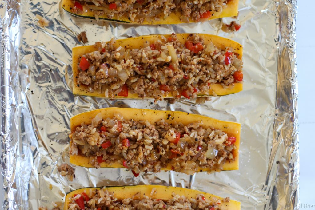 This Stuffed Delicata Squash Recipe uses chicken sausage, brown rice and white wine and is so flavorful