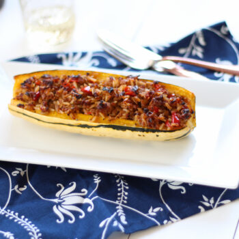 This Stuffed Delicata Squash Recipe is uses chicken sausage and is so flavorful