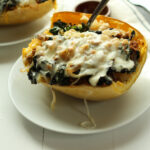 Sausage and Kale Spaghetti Squash Boats! So good! And healthy! Spicy Sausage and Garlicky Kale all topped with melty cheese make this low carb and gluten free meal perfectly satisfying.
