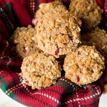 These muffins are super moist and made with cranberry sauce and fresh cranberries with hints or orange and brown sugar.
