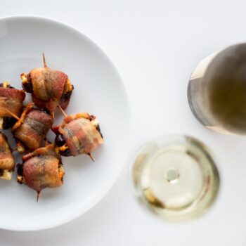 Goat Cheese Stuffed Bacon Wrapped Dates - these are so easy, only take 3 ingredients and are wildly addictive! They will dissapear before you know it.
