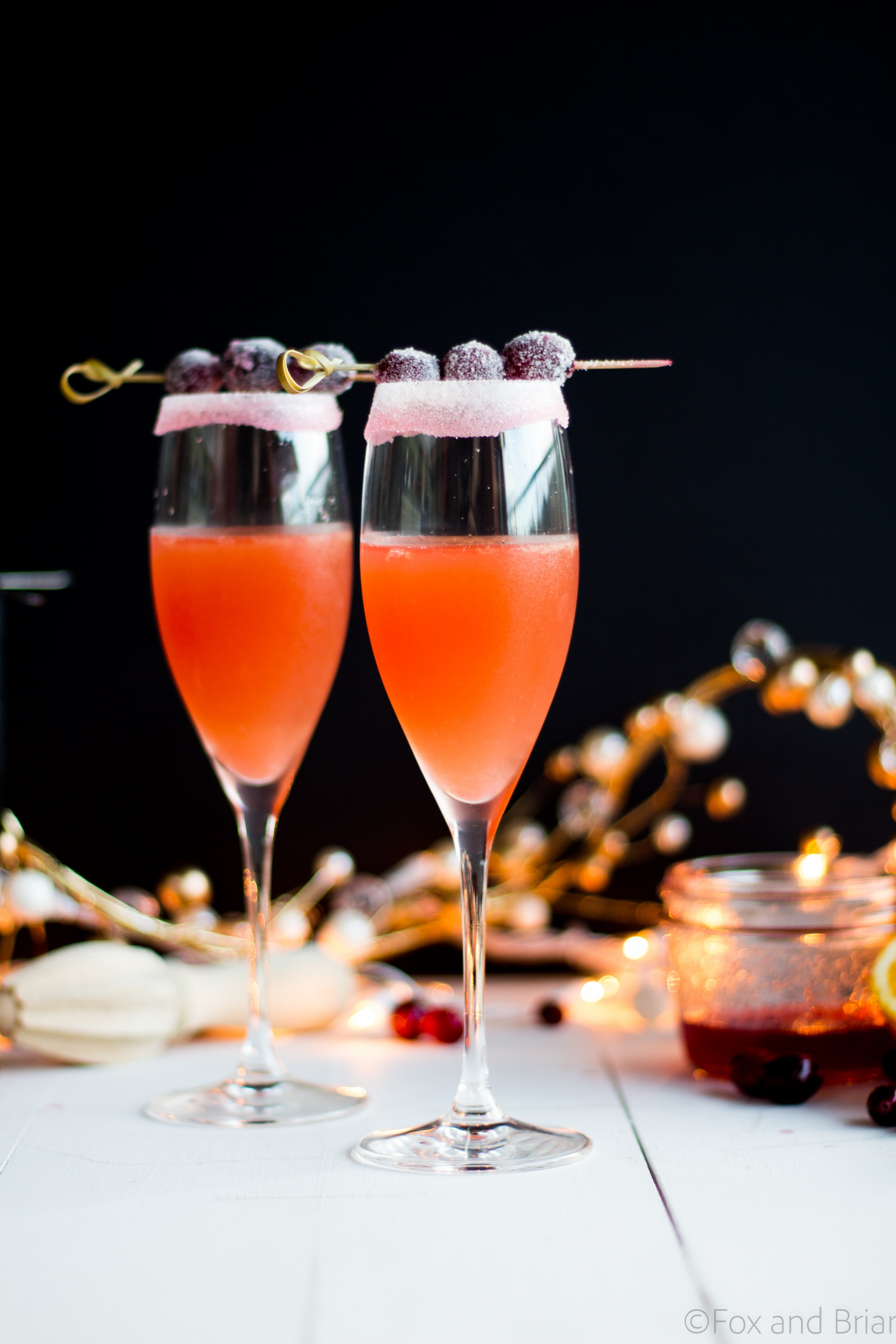 Homemade cranberry orange syrup takes this standby cocktail up a notch. Cranberry Sauce, Grand Marnier, Orange juice and cranberry orange syrup combine to make a festive winter cocktail. There is a non-alcoholic mocktail version as well!