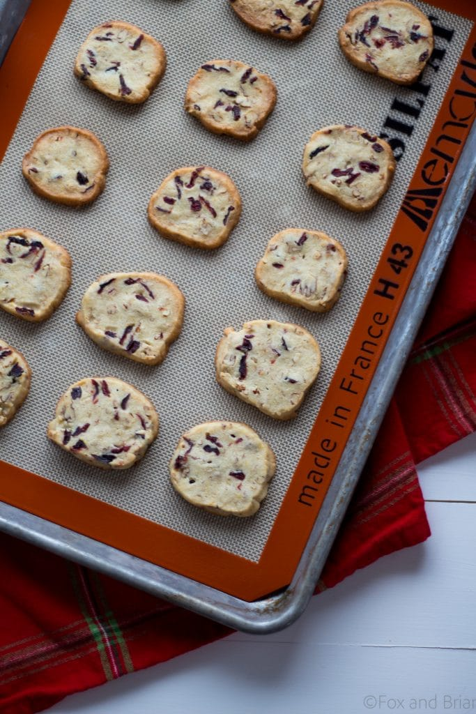 Cranberry Orange and Pecan Shortbread cookies. These easy, slice and bake cookies are flavored with orange zest, vanilla, cranberries and pecans. They are the perfect holiday cookies to give away or keep for yourself!