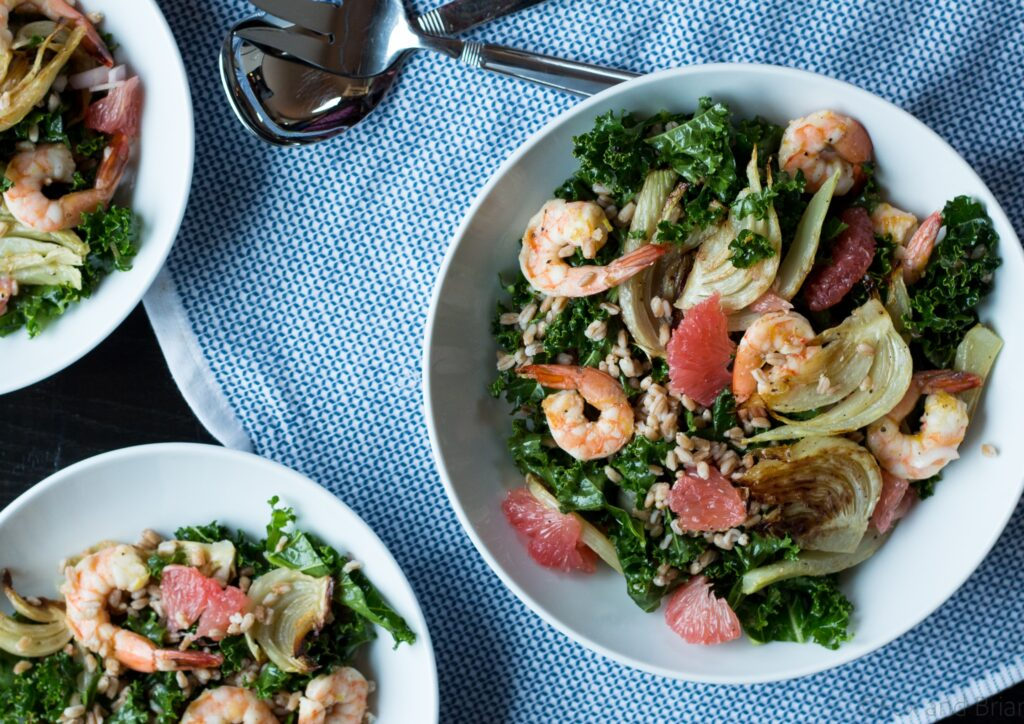 This hearty winter salad has roasted fennel and shrimp with the bright flavor of grapefruit, plus farro and kale for a nutritionmal powerhouse!