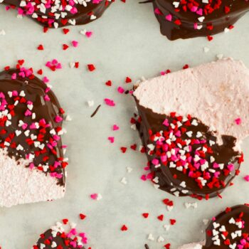 These Homemade Strawberry Marshmallows are fun and simple to make, and have amazing strawberry flavor. No high fructose corn syrup or dyes! A fun treat for Valentine's day or any other time of year!.