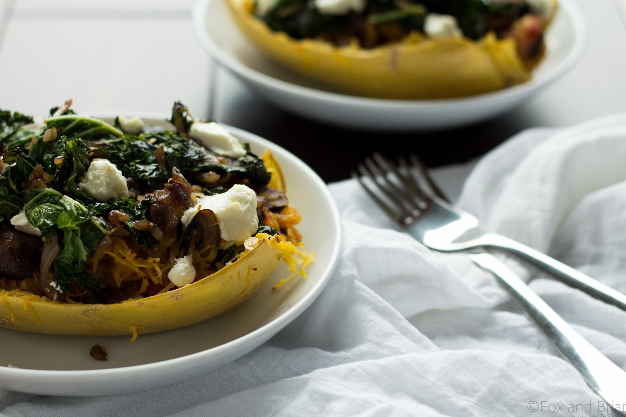 These veggie spaghetti squash boats are vegetarian, with kale, mushrooms and goat cheese. So packed with flavor and super healthy!