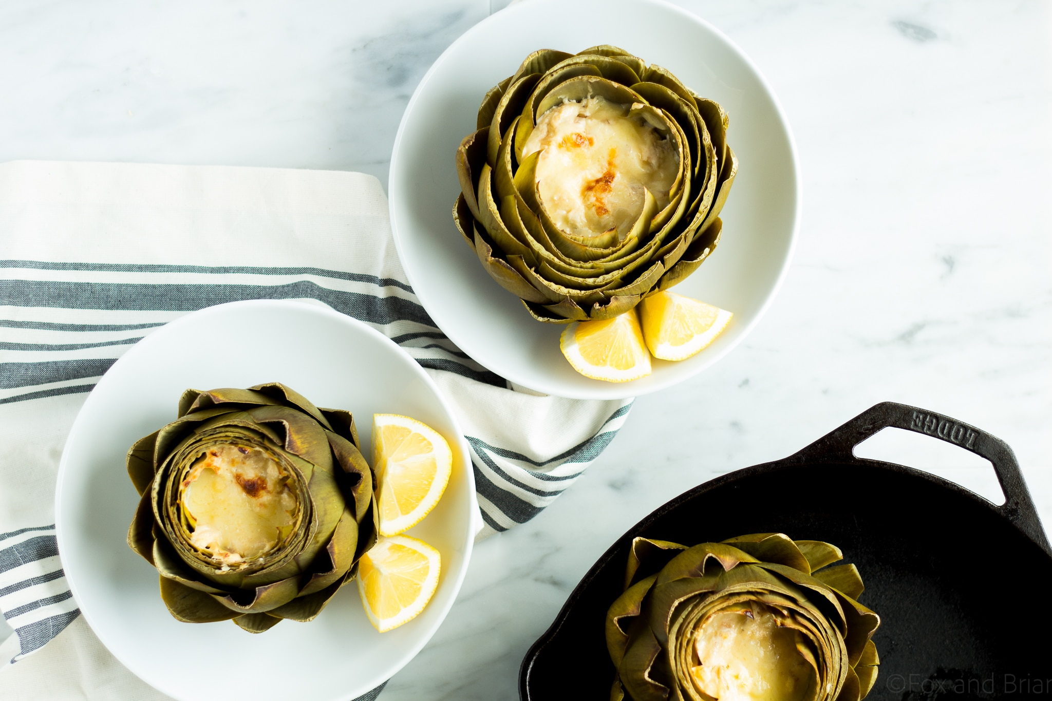 These Hot Crab Dip Stuffed Artichokes deserves a spot on your holiday or party table! Artichokes stuffed with a rich and cheesy crab dip, then baked until melty. You can use the artichoke leaves to scoop the dip!