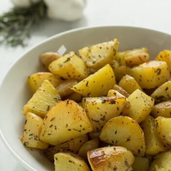 Golden potatoes roasted with garlic and rosemary are your perfect side dish.