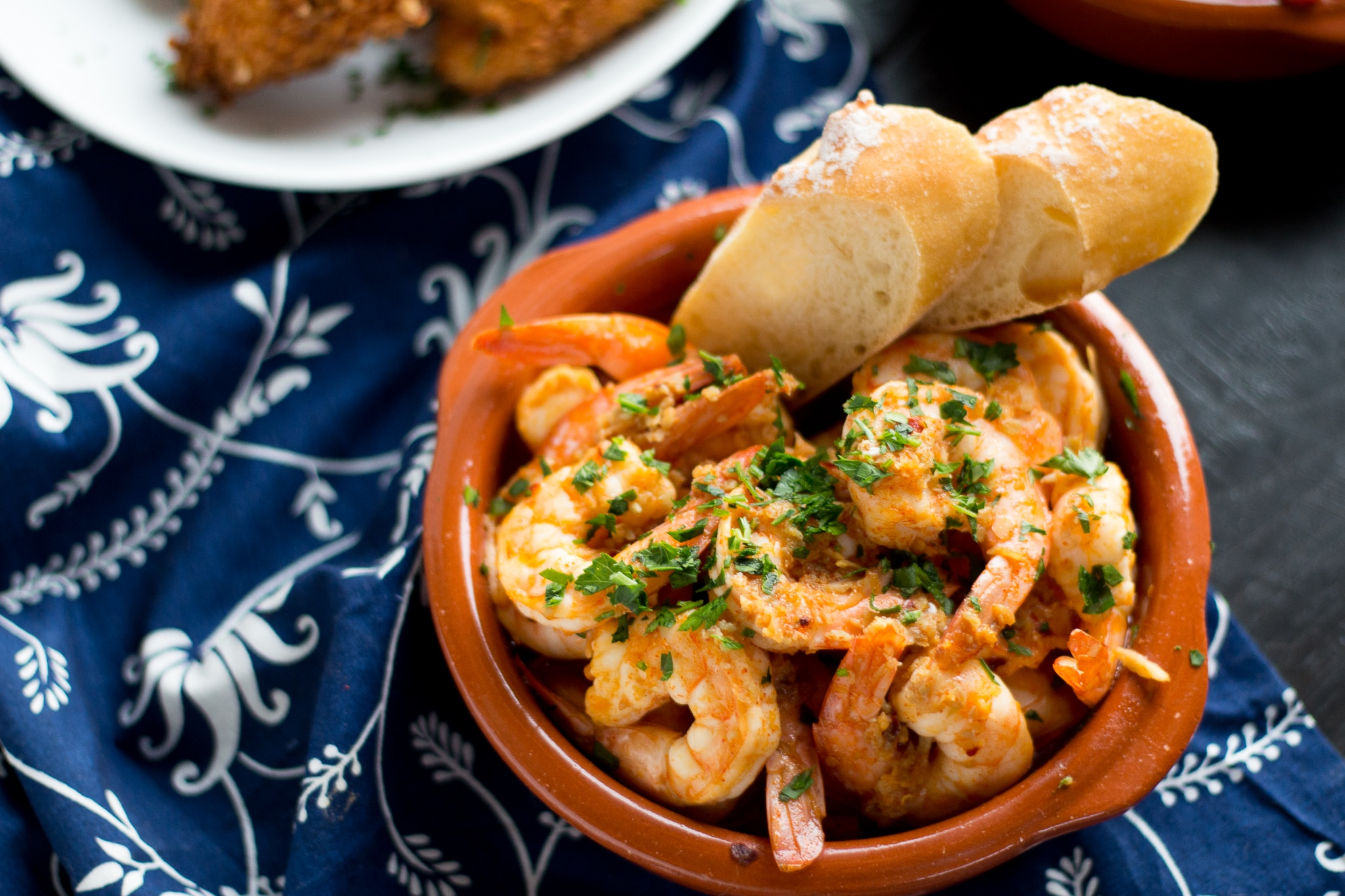 Garlic Shrimp (Gambas al Ajillo) are a classic Spanish tapas dish. Succulent shrimp in a spicy garlicky sauce that you will need to dip your bread into!