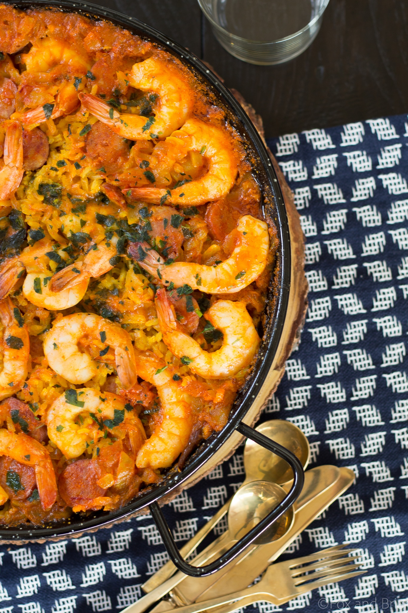 This spanish dish Paella is easy to make, has classic Spanish paella ingredients and is an impressive crowd pleaser.