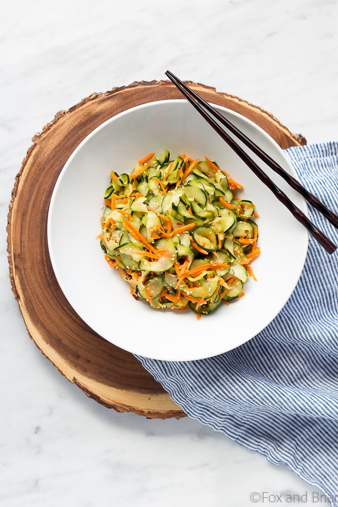 This Sesame Carrot and Cucumber Slaw is a cool and crisp side dish perfect for hot weather! It takes under 15 minutes to make, and is vegan and gluten free!