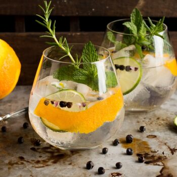 These Spanish Style Gin Tonics are the perfect refreshing sipper for a hot summer day! Ice cold, filled with aromatics, gin and high quality tonic, they are sure to cool you down!