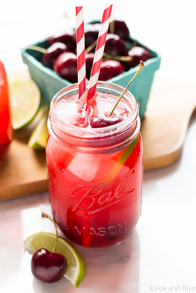 This Sparkling Cherry Limeade uses only four real ingredients - cherries, limes, water and sugar! Cherry Simple syrup mixes with lime juice and sparkling water to make a refreshing summer beverage that everyone can enjoy!