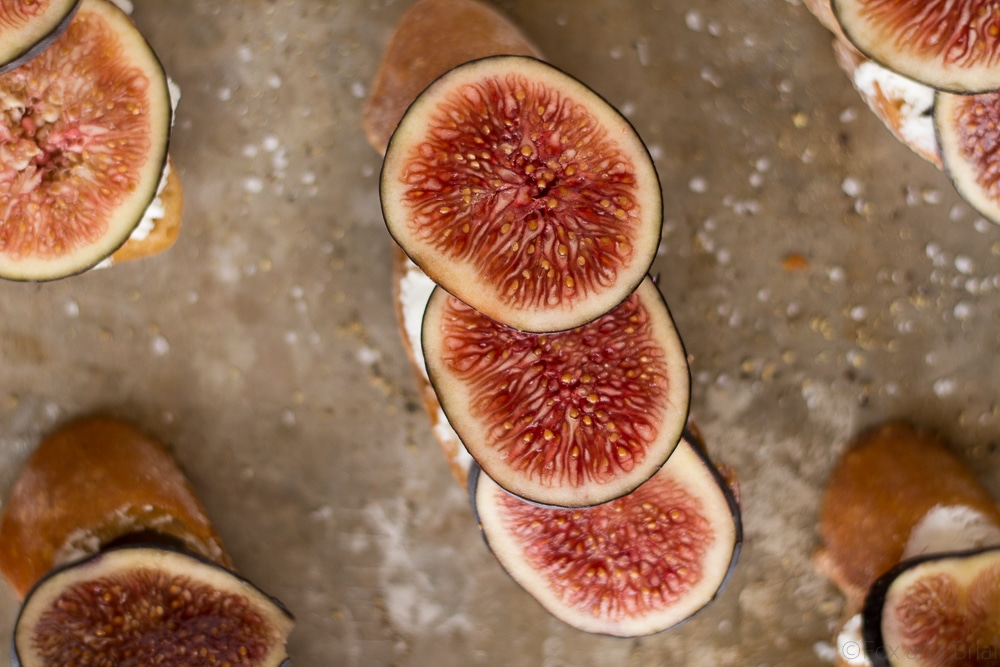 These Fig and Goat Cheese Crostini with Honey are one of my favorite simple summer appetizers. Using fresh figs, goat cheese, honey and pepper, these are an easy but elegant starter or snack.