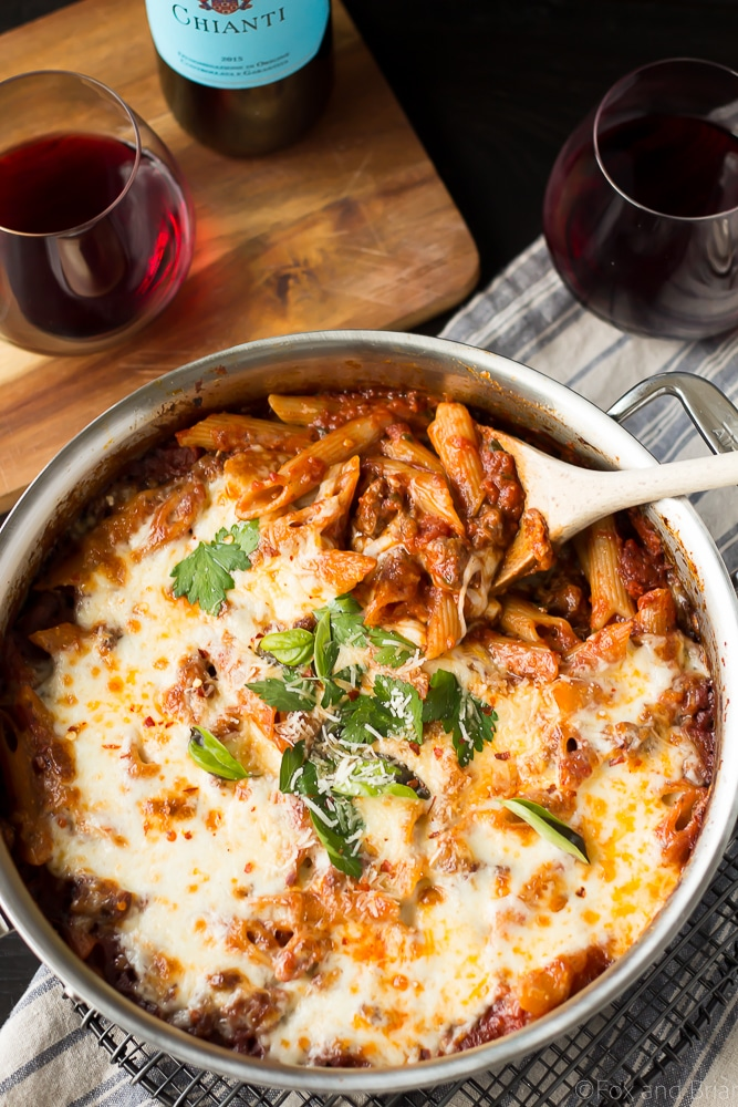 This easy One Pot Pasta Bake with Sausage and Wine only uses one pan - you don't even need to boil the noodles! It only takes about ten minutes to prep, then just bake it in the oven while you do something else! You won't believe how easy it is to make this delicious, cheesy pasta dinner! #sponsored #TasteofItaly