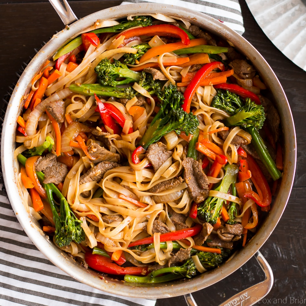This quick and easy Beef Noodle Stir Fry takes under 30 minutes and is easily made gluten free! Full of veggies, beef and a flavorful sauce, your whole family will love it!