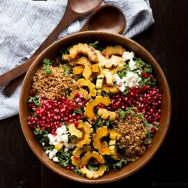 This Autumn Harvest Salad uses the beautiful produce available as the months start to get colder, such as delicata squash, kale, and pomegranates, as well as farro and goat cheese to make a hearty cold weather salad. Then it is all tossed together with a maple apple cider vinaigrette!