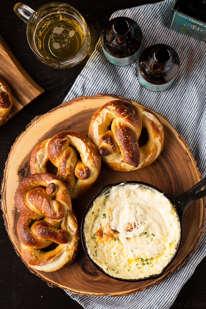 These Soft Beer Pretzels with Beer Cheese Dip are soft and fluffy pretzels with a cheesy dip. Perfect for game day, parties, or any time you need a snack to go with your beer. #ad