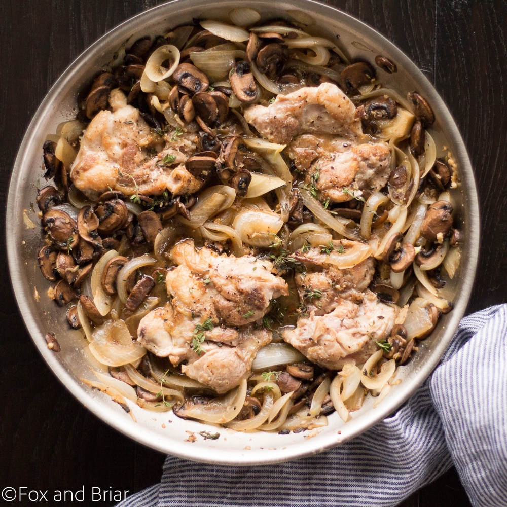 Skillet Chicken and White wine Mushrooms is a fast and easy dinner recipe. Juicy Chicken thighs with a white wine mushroom sauce that has no cream!