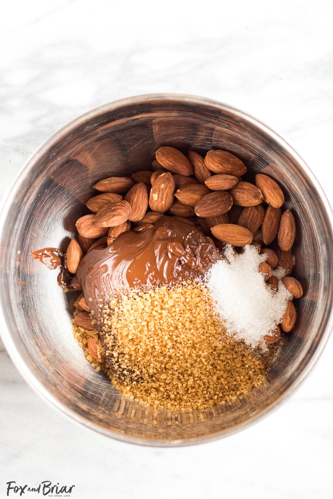 Dark Chocolate Almonds with Sea Salt and Turbinado Sugar just like Trader Joe's, but you can make them at home! Only four ingredients and a few minutes is all it takes to make these healthy and delicious treats.