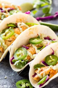 Chipotle Lime Fish Tacos with crunchy jalapeno lime slaw and creamy avocado crema are an easy and flavorful weeknight dinner! Taco Recipe   Baja Fish Tacos   Spicy Fish Tacos   Fish Recipes   Cinco De Mayo Recipes