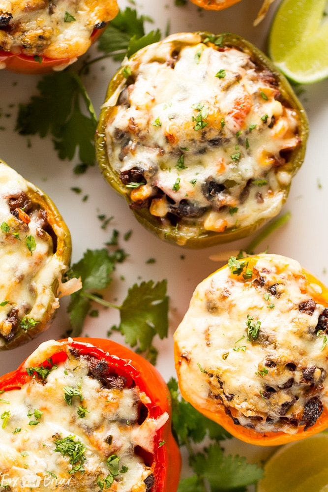 These Tex-Mex Stuffed Bell Peppers are a grain-free, gluten-free family friendly dinner with Mexican flair. Sure to satisfy everyone at the dinner table! #ad @krogerco | Gluten free dinner | Easy Dinner Recipe | Ground Beef Recipes | Stuffed Bell Peppers