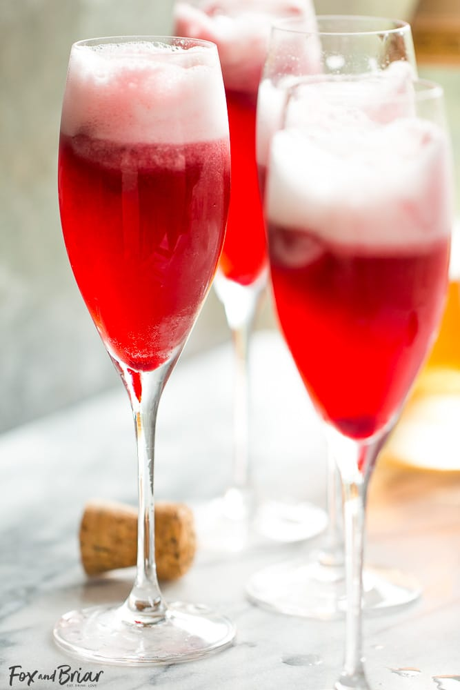Rosé Raspberry Sorbet Mimosas are a fun cocktail for Mother's Day, bridal showers, brunch or just a girls get together. These girly cocktails are so easy to make and everyone will love them!   Bridal Shower drinks   Mother's Day drinks   Brunch cocktails   easy mimosa   sorbet mimosa   pink drink