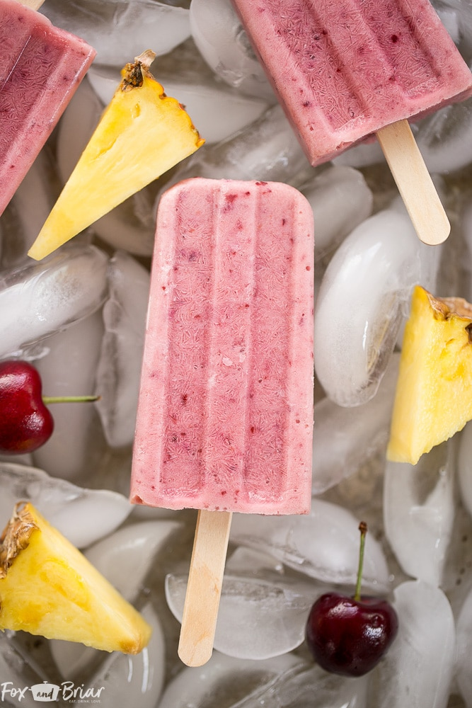 These Post Workout Smoothie Popsicles will keep you cool and refuel your body after a tough workout! Perfect for hot summer days, these healthy popsicles have no added sugar and and are a grab and go snack on busy days. | No added sugar popsicles | healthy popsicles | Healthy snack | Sugar Free Snack |