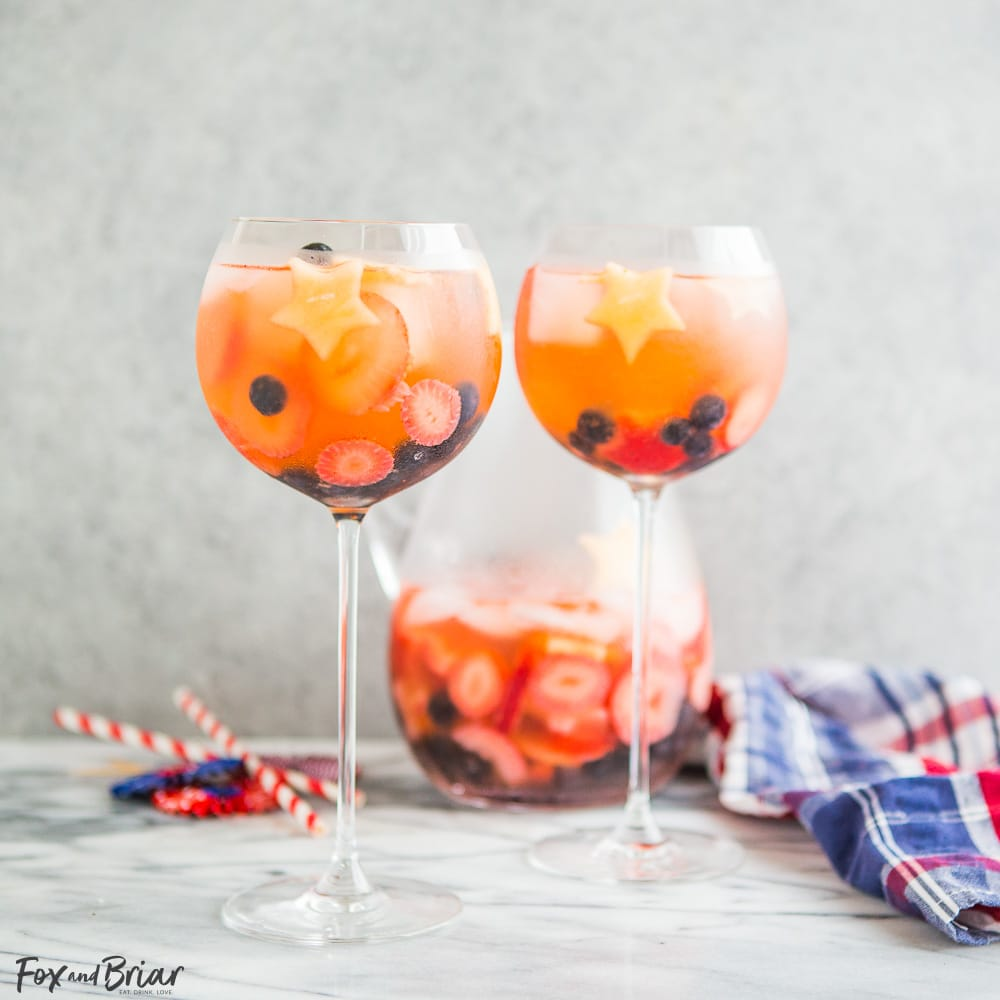 These Red, White, and Blue Wine Sparklers are the perfect festive drink for the Fourth of July. Refreshing and light on alcohol makes for easy drinking on a hot summer day! |patriotic drinks | red white and blue drinks | patriotic recipes | red white and blue recipe | fourth of july recipe
