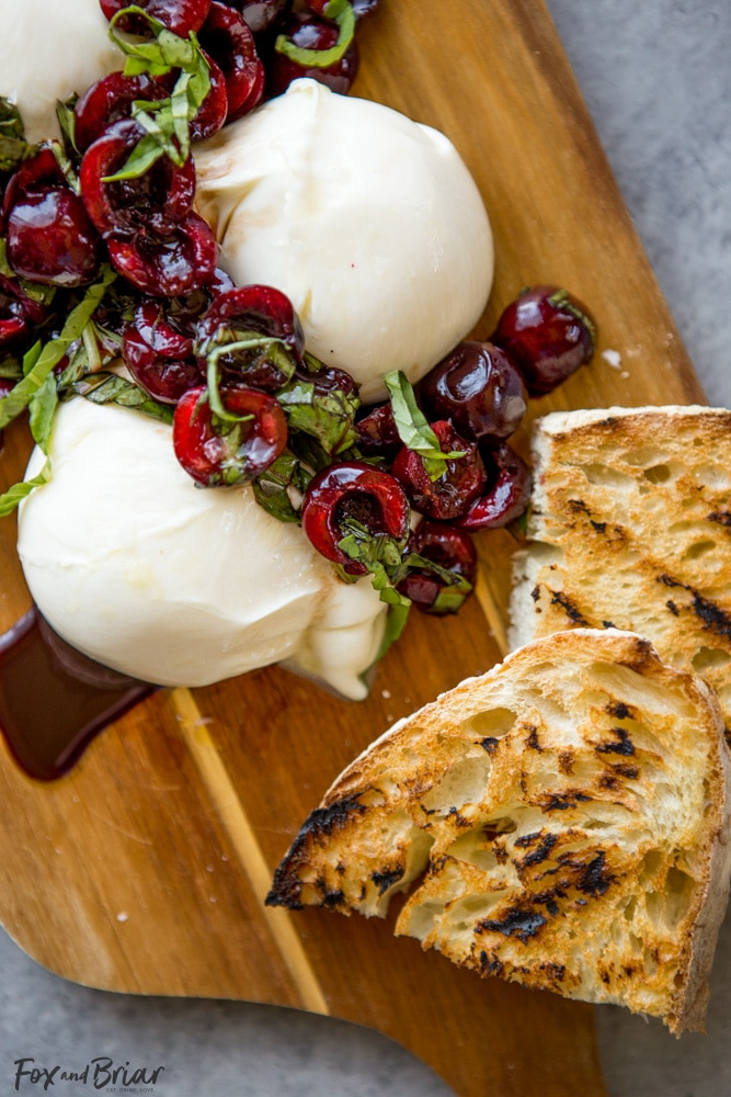 This Burrata with Balsamic Cherries and Basil the ultimate summer appetizer! Creamy, fresh burrata paired with juicy cherries and fragrant basil uses summer produce at its best, and no cooking required! Summer appetizers | Cherry Recipes | basil Recipes | burrata Recipes | party appetizers