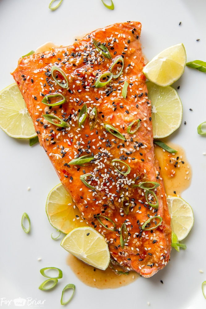 This Baked Sweet Chili Garlic Salmon will be your favorite way to eat salmon! This quick and easy salmon recipe only takes 20 minutes and is packed with sweet, tangy and spicy Asian flavors that will become a family dinner favorite. |Easy dinner recipe | 20 minute dinner | Quick Dinner Recipe | Salmon Recipe | Fish Recipe | Asian Salmon