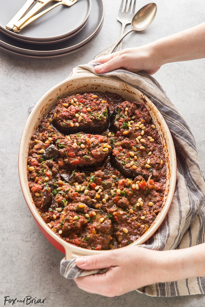 This Meat Stuffed Eggplant is full of delicious flavor, and is a hearty and low-carb dinner! Cinnamon-scented lamb, tomatoes and toasted pine nuts make this dish unique and you will want to keep coming back for more! | Lamb Recipes | Eggplant Recipes | Low Carb Dinner Recipes | Gluten Free Recipes | Winter Recipes | Middle Eastern Recipes | Syrian Recipes
