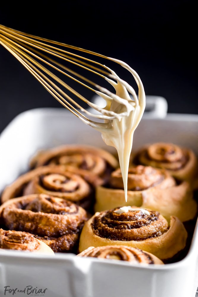 These giant, soft, Eggnog Cinnamon Rolls are the perfect Christmas morning breakfast! Gooey, pillowy and full of cinnamon spice with an extra holiday pop of eggnog flavor in the creamy icing. | Christmas Morning Breakfast Recipe | Eggnog Recipes | Holiday Recipe | Christmas Brunch Recipe | Holiday Brunch | Holiday baking | Christmas Baking