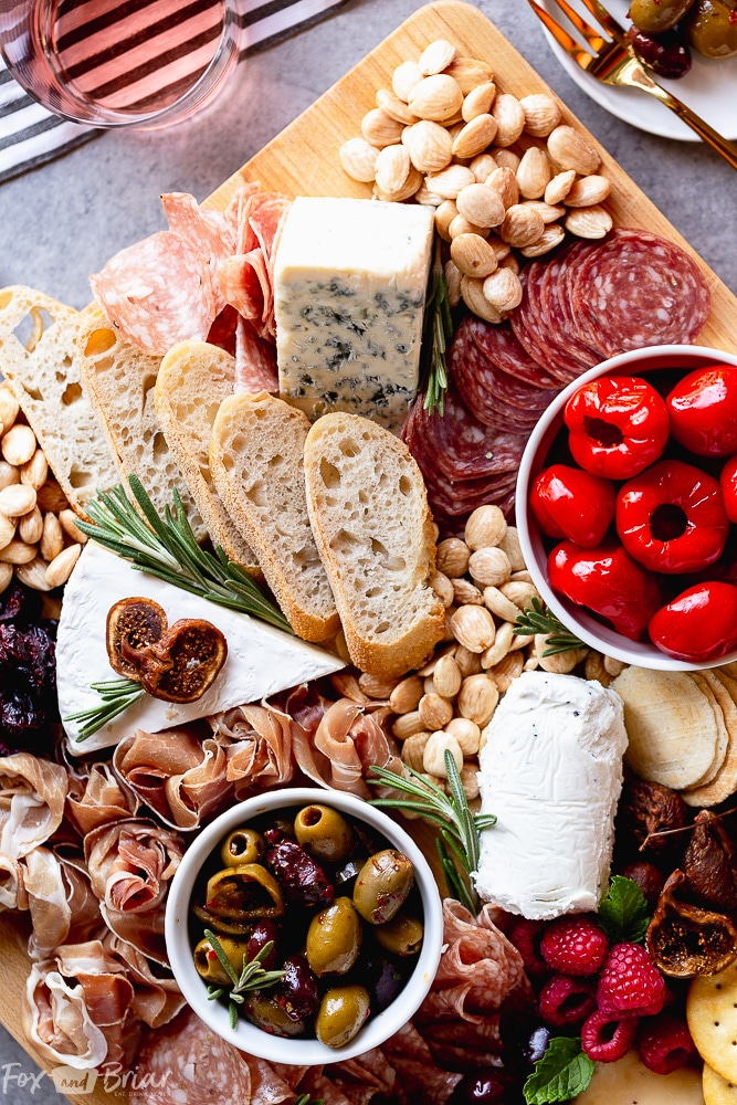 No party is complete without an epic charcuterie board.  Follow these step by step photos to learn how to make a charcuterie board. | how to make a cheese board | party appetizer | holiday appetizer | cheese and wine | Charcuterie ideas | Cheeseboard ideas | cheese board for holidays | summer cheese board | Fall Cheeseboard | Party platter #ad @qfc