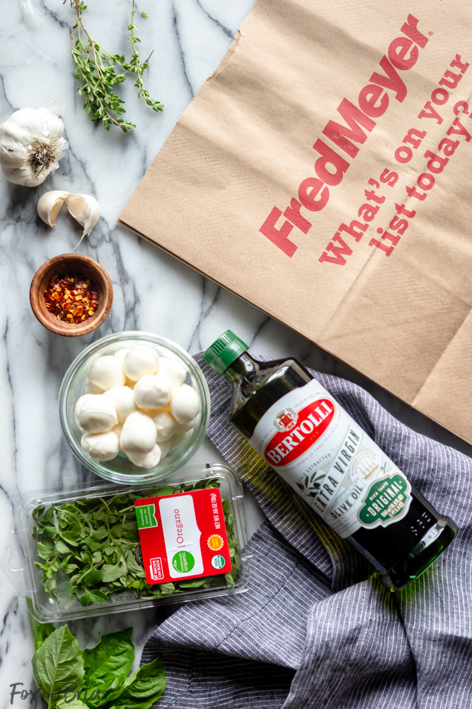 These Olive Oil Marinated Mozzarella Balls are a quick and easy appetizer that takes less than 15 minutes to make. @bertolli #ad #TheRecipeIsSimple | Make Ahead | For a party | Quick | For a crowd | cold appetizer | no cook | bites | finger food | snacks | Low carb appetizers