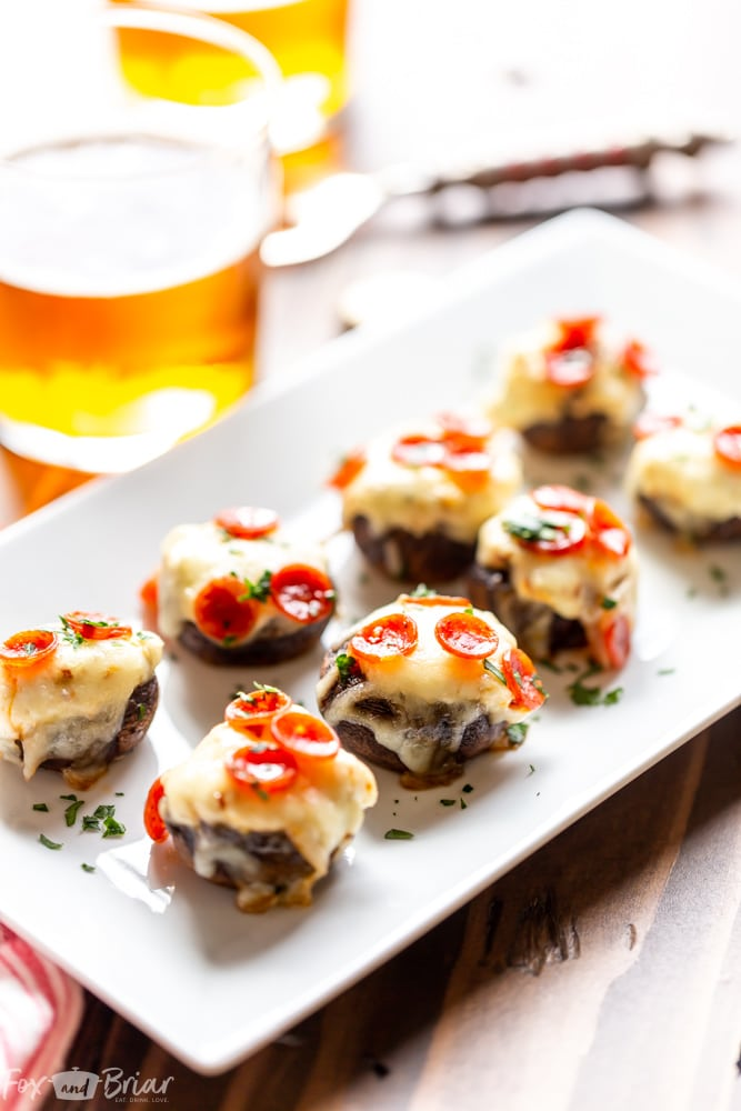 These Pizza Dip Stuffed Mushrooms are bite sized appetizers, perfect for game day.  These low carb, easy stuffed mushrooms have big pizza flavor. Easy stuffed mushrooms | Low Carb Stuffed Mushrooms | Keto Stuffed Mushrooms | Football Party Food | Tailgaiting food | Stuffed mushroom appetizers | Gluten free stuffed mushrooms | for kids | for families | superbowl party food | Thanksgiving appetizer | Christmas appetizer