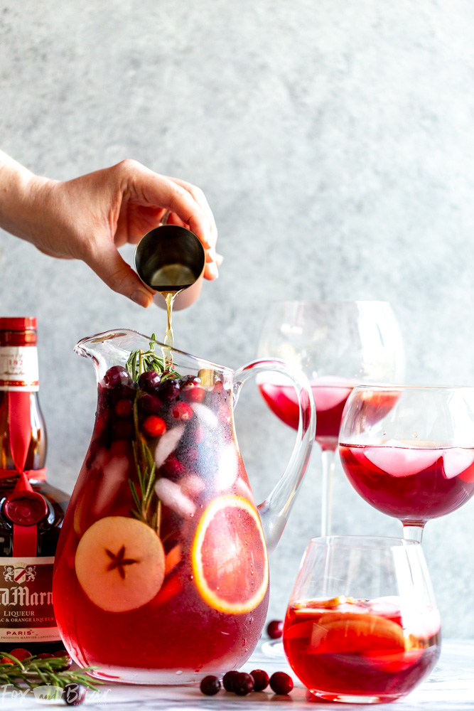 This Cranberry Orange Sangria Recipe is the perfect cocktail for Thanksgiving or Christmas parties!  Easy to mix together, and you can make it ahead of time, this festive sangria will be a hit! |Easy Sangria Recipe | White Sangria | Thanksgiving Sangria | Christmas Sangria | Sangria for a crowd | Thanksgiving cocktail | Christmas party | Winter Sangria | Holiday Sangria
