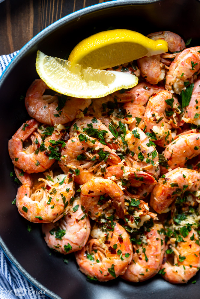 These Easy Garlic Butter Shrimp are the most delicious shrimp you will ever make! Using Argentinian Red Shrimp, garlic, butter and lemon, this simple recipe is packed full of flavor! | Shrimp recipe | Easy shrimp recipe | Garlic shrimp | Shrimp for dinner | Simple Shrimp recipe | Low carb Shrimp recipe | Sauteed shrimp | Quick Shrimp recipe | Lemon garlic shrimp | Skillet shrimp