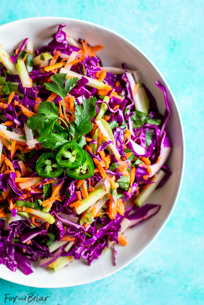 Chayote Recipe - Cilantro Lime Chayote Slaw is crunchy and vibrant. Using chayote squash, cabbage, carrots and jalapeno this slaw is perfect for tacos. It also makes a great light and healthy side dish for any dinner! Healthy recipe | Taco Slaw | Cabbage recipe | Low fat | Low Carb | Low Calorie | health benefits of chayote | What is chayote | How to cook chayote | Chayote recipes | Mexican Recipes | What to serve with tacos