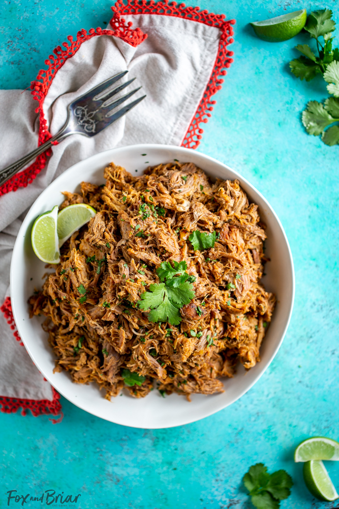 This delicious Slow Cooker Carnitas recipe is tender and juicy, yet simple to make.  Mexican pulled pork is great to have on hand for carnitas tacos, burrito bowls, salads, sandwiches and more. | Easy pork carnitas | Crock Pot Carnitas | Chipotle copycat | Crispy carnitas | Keto Carnitas