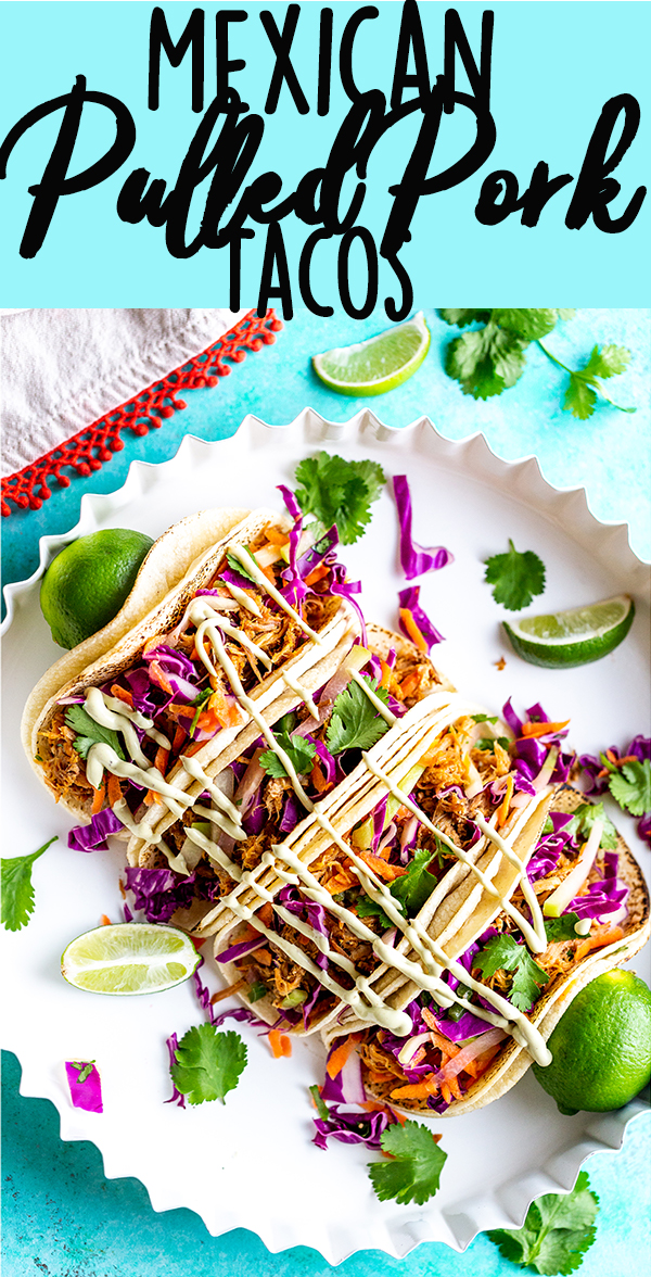 These Slow Cooker Mexican Pulled Pork Tacos have juicy pulled pork, crunchy cilantro lime slaw and creamy avocado crema, all piled in a soft tortilla.  Slow Cooker Pork Tacos | Easy Pork Tacos | Pulled Pork Tacos | How to make pork tacos at home | Shredded pork tacos | Carnitas