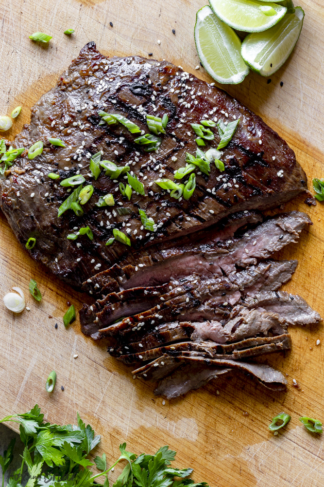 Grilled flank steak on a cutting board