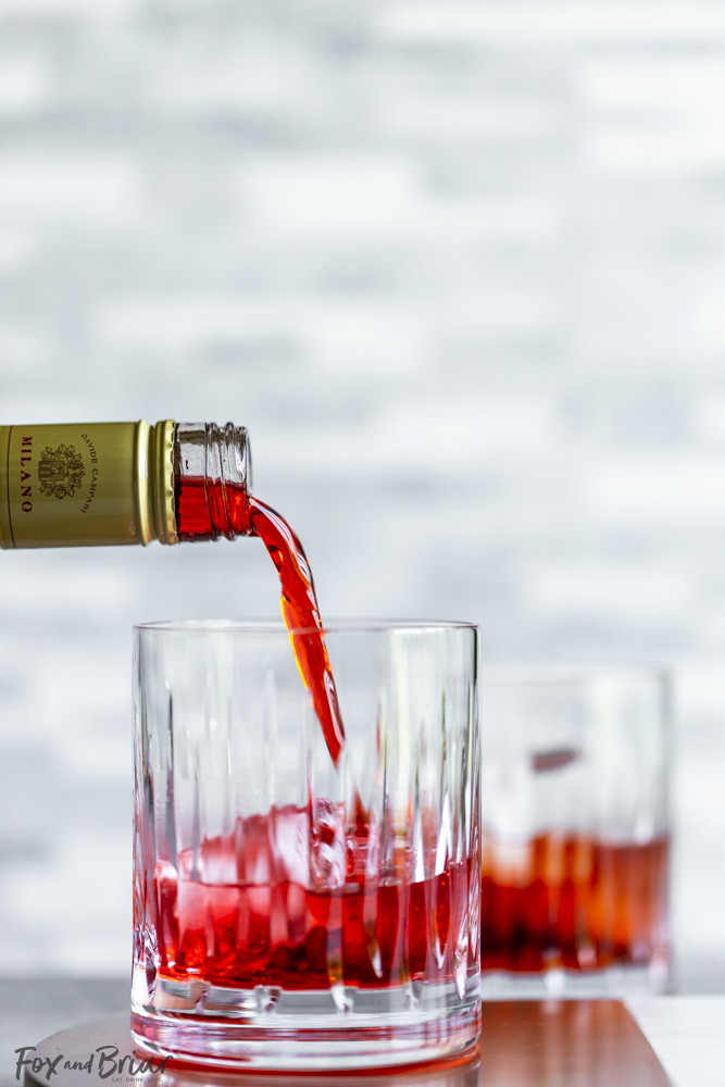 campari pouring into glass