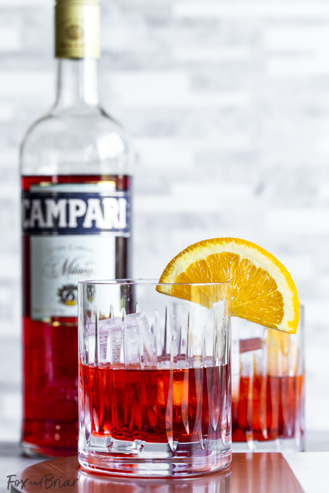 Finished negroni with bottle of campari