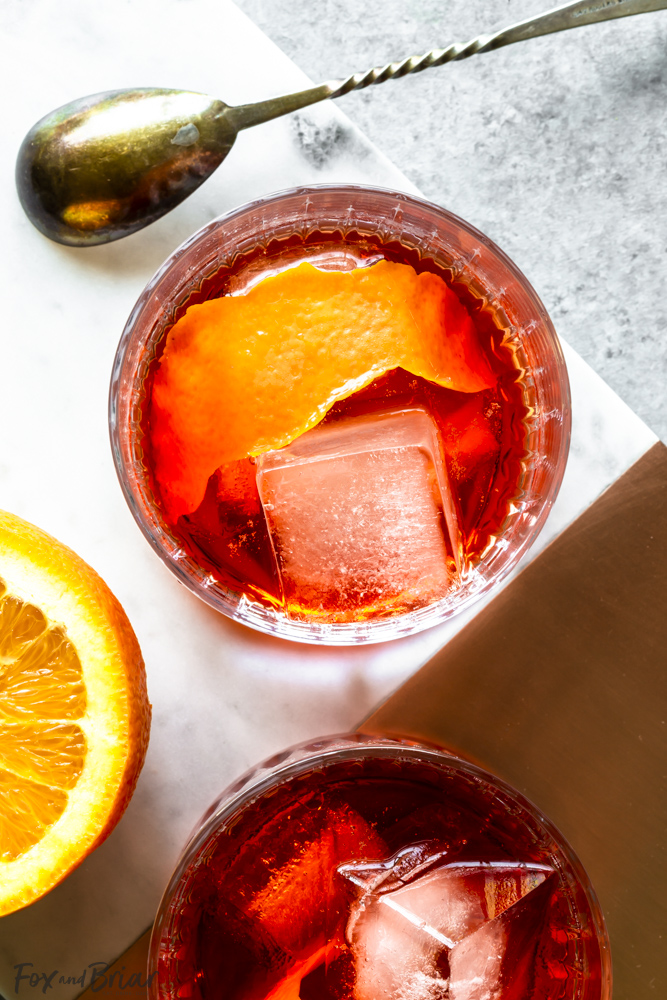 Closeup overhead of negroni with ice and orange peel
