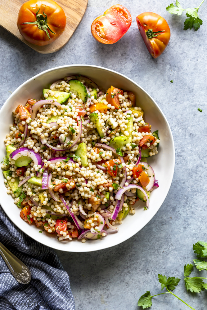 Vegan couscous salad with tomatoes