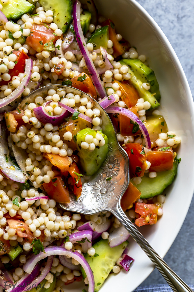 Pearl Couscous salad with cucumbers, tomatoes and onion