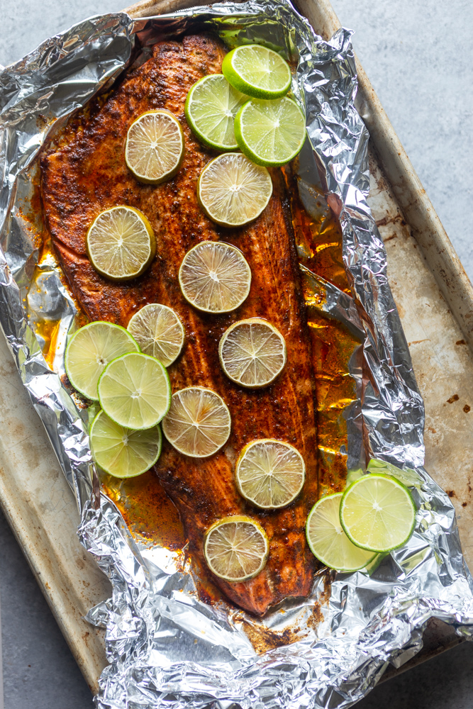 This Chili Lime Baked Salmon is so simple, fast and full of flavor! A quick chili lime sauce is brushed on the salmon before it is roasted for about 15 minutes. Try this easy Oven Baked Salmon for dinner tonight! |Easy salmon Recipe | keto low carb | healthy dinner idea | quick salmon recipe | fish recipes | seafood recipes
