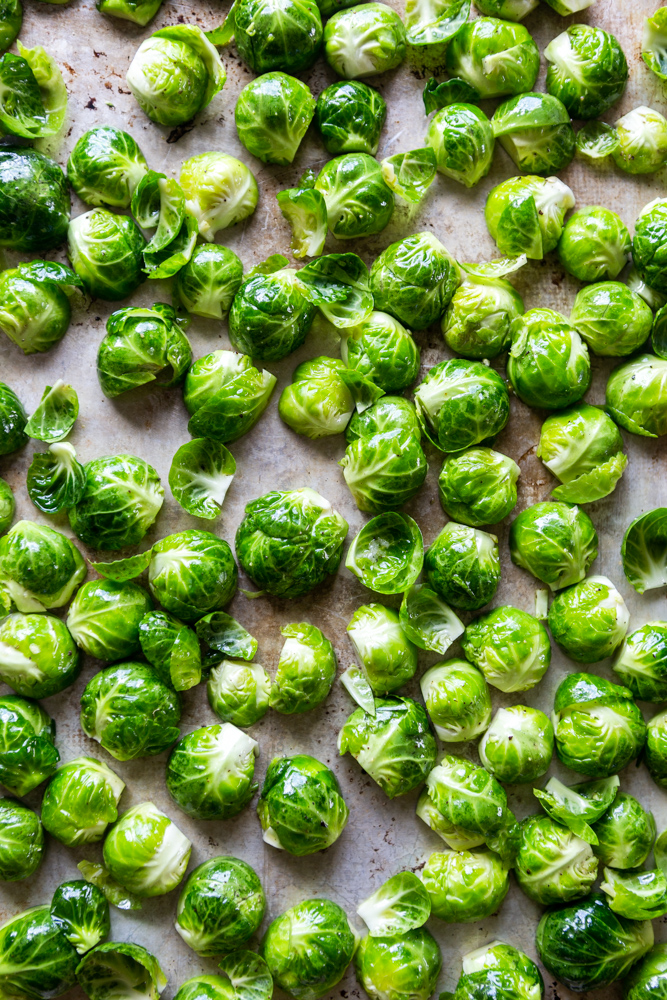 These Easy Roasted Brussels Sprouts have only four ingredients and are so simple to make!  Brussels Sprouts make a great side dish for a weeknight dinner or even a special holiday meal like Thanksgiving or Christmas! | oven baked brussels sprouts | easy brussels sprouts | side dish recipes | Christmas dinner ideas | thanksgiving recipes | thanksgiving side dishes | easy side dishes | brussels sprouts recipes